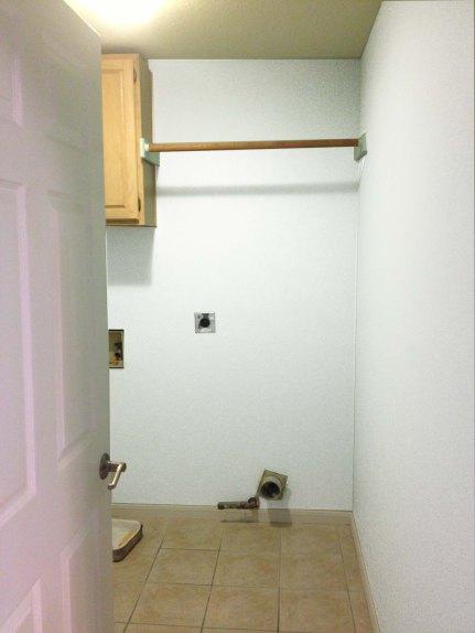 Boring white laundry room
