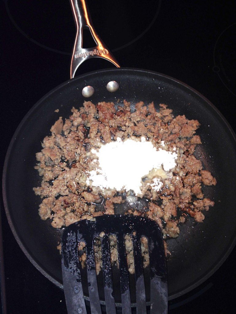 DO NOT drain your sausage. Sprinkle 1/2 cup to 1 cup flour on top of sausage.