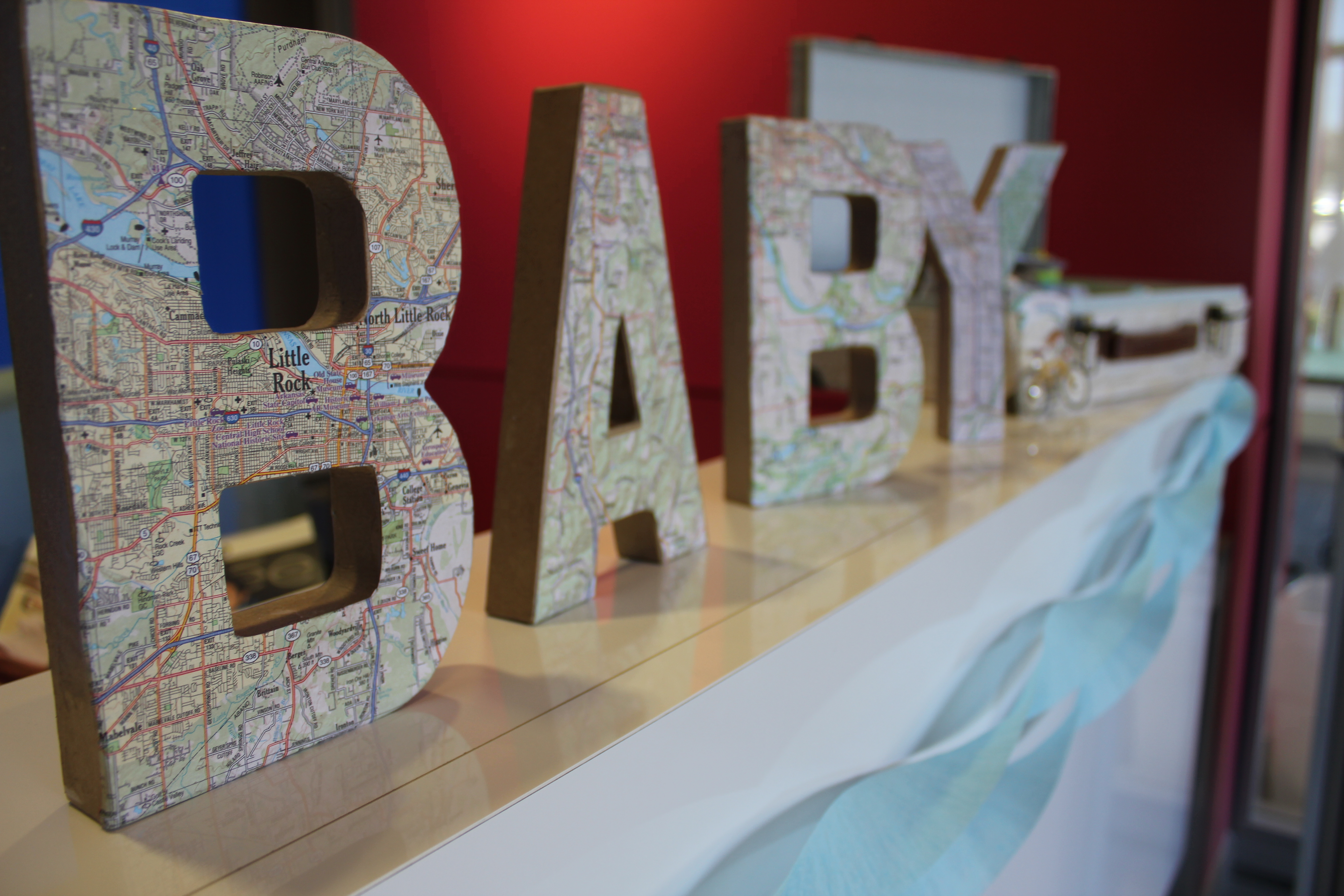 Welcome to the world baby shower for a boy map decor details the maps used to create the word baby were all maps of cities about the mommy and her hubby their hometowns the city they started dating and where they gumiabroncs Image collections